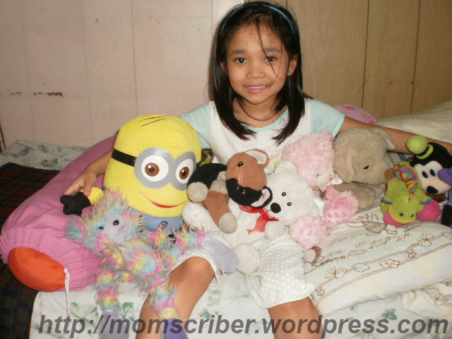 singing with her stuffed toys